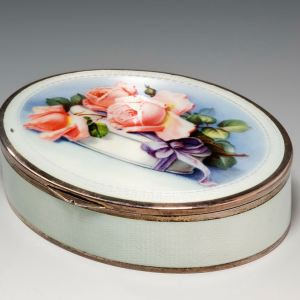 ANTIQUE SILVER GILT AND ENAMEL OVAL BOX