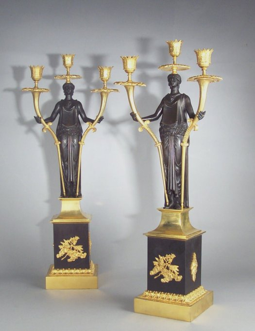 ANTIQUE PAIR OF RUSSIAN BRONZE AND ORMOLU FIGURAL CANDELABRA