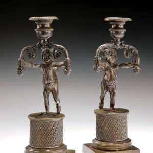 ANTIQUE PAIR OF BRONZED CHERUB CANDLESTICKS