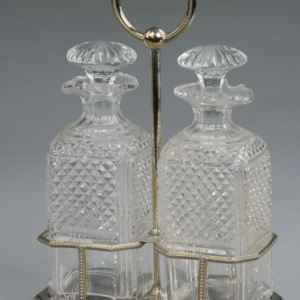 ANTIQUE PAIR OF GLASS DECANTERS IN SILVER PLATED STAND