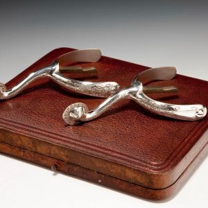 BOXED PAIR OF ANTIQUE ENGRAVED SILVER SPURS