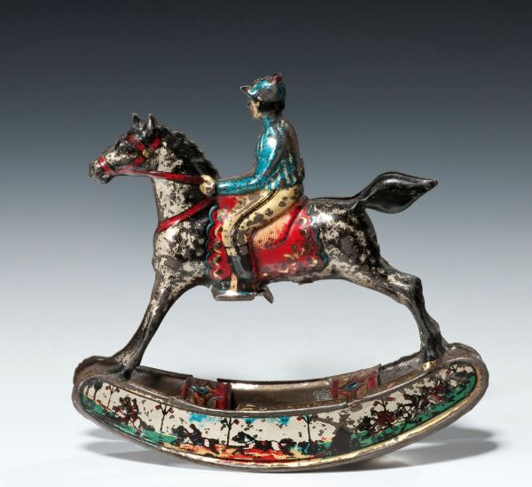 ANTIQUE PENNY TOY OF A ROCKING HORSE BY MEIER