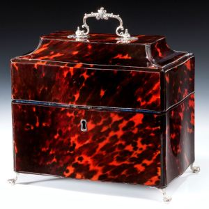 PAIR OF GEORGE III SILVER TEA CADDIES IN A RED TORTOISESHELL CASE