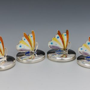 FOUR ANTIQUE SILVER AND ENAMEL MENU HOLDERS