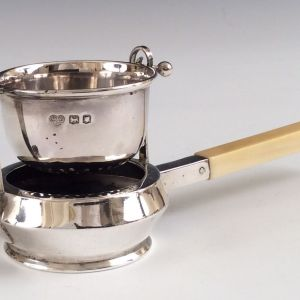 ANTIQUE SILVER TEA STRAINER AND STAND