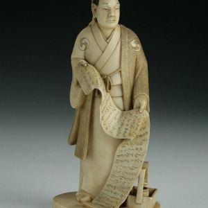 JAPANESE IVORY OKIMONO OF A SCHOLAR