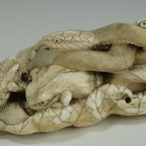 JAPANESE IVORY OKIMONO OF A SNAKE AND FROGS