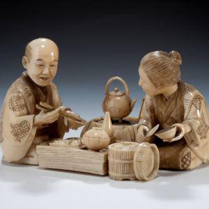 JAPANESE IVORY OKIMONO MAN & WOMAN