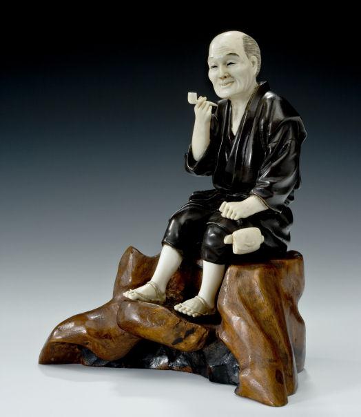 ANTIQUE JAPANESE BRONZE AND IVORY OKIMONO OF A MAN
