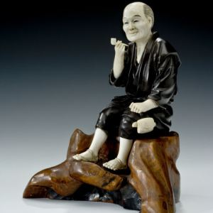 ANTIQUE JAPANESE BRONZE AND IVORY OKIMONO OF A MAN