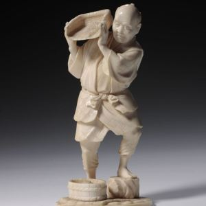 JAPANESE IVORY OKIMONO OF A FARMER