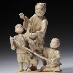 JAPANESE IVORY OKIMONO OF A MAN CHILDREN AND MONKEY