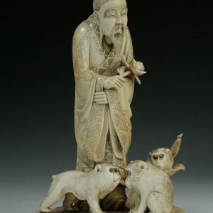 JAPANESE IVORY OKIMONO OF A MAN AND MONKEYS