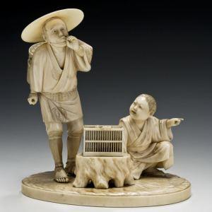 JAPANESE IVORY OKIMONO OF A PEASANT AND BOY
