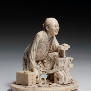 JAPANESE IVORY OKIMONO OF A CARPENTER