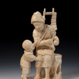 JAPANESE IVORY OKIMONO OF A WOMAN AND CHILD