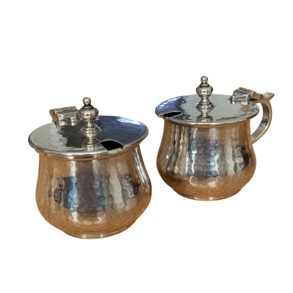 PAIR OF ARTS & CRAFTS SILVER MUSTARD POTS BY A E JONES