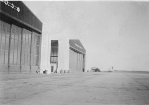 """View of the hangars."" (Note B-18 in background)"