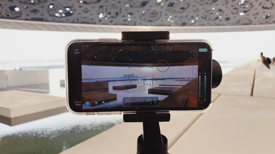 The Moza Mini S set up on a ledge inside the Louvre Abu Dhabi. Close up of the iPhone XR mounted in the gimbal.
