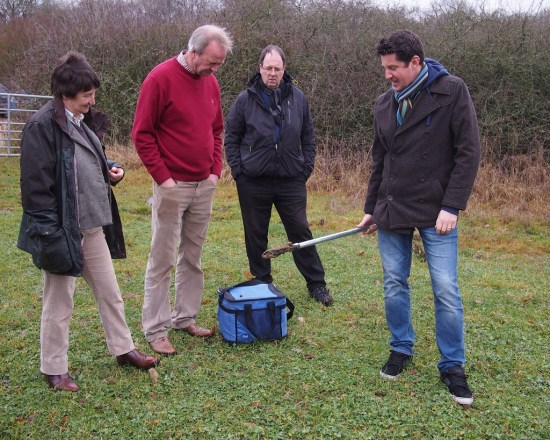 Simon demonstrating sampling in grassland
