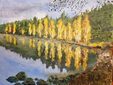 Reflection of autumnal leaf colour in lake