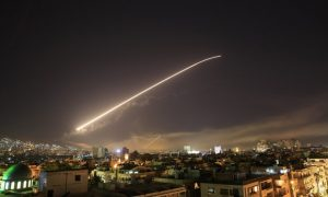 A missile crosses the night sky over Damascus
