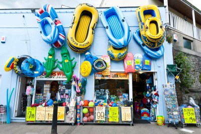 inflattable toy dingy at shop in tenby