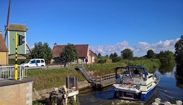 Canal, Boat and Windmill at Lo