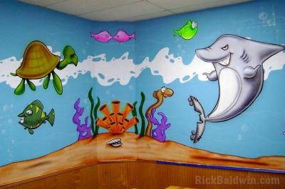 Cartoon mural of underwater aquarium