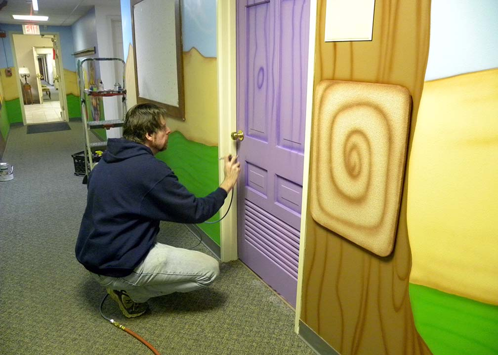 Atlanta Muralist Rick Baldwin Painting a Kids Room