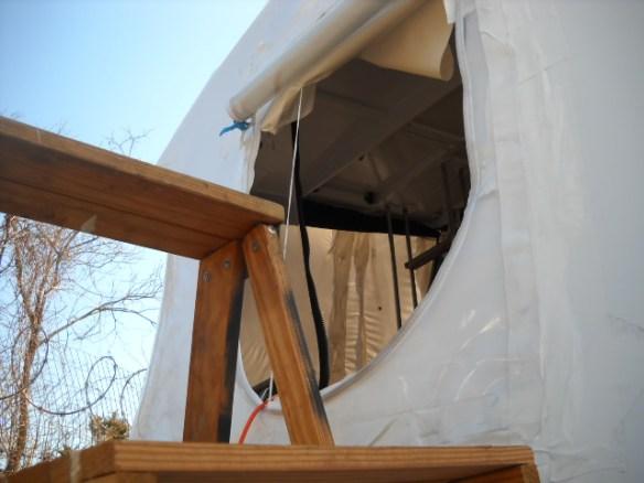 Access door in the shrink wrap.