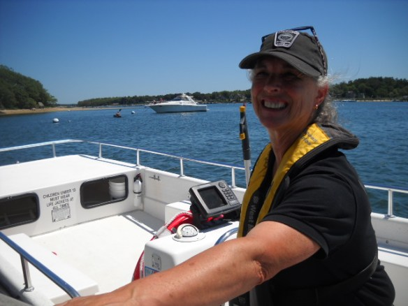 The friendly Harbormaster stops by to collect her fee.