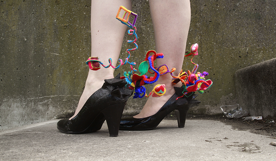 Origin of Joy shoes for a costume with black geometric clusters and organic forms in bright colored fabrics.