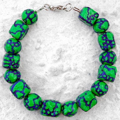 Blue en green hand crafted and painted bracelet called Particles XIII, made by Veerle Ritstier