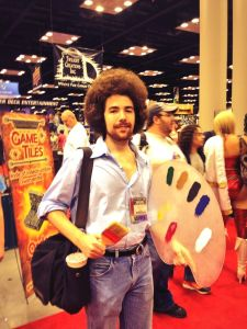 Bob Ross, from The Joy of Painting. This costume thrilled me so much that I called Scott over to see it. Right in front of a very attractive, scantily clad woman who turned out to be a professional cosplayer. I felt that I had been very rude, afterwards, and I'm sorry about that. But still - Bob Ross cosplay! Right?