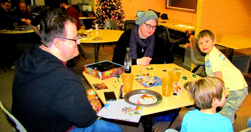 Erik, Sigrid, Bjorn, and Soren managed to make it by. Here, they're playing King of Tokyo.