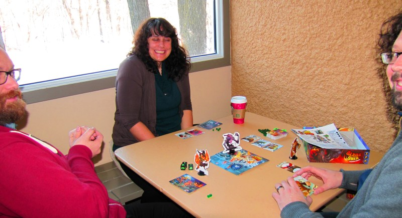 Melly, Matt, and Elliot playing King of Tokyo