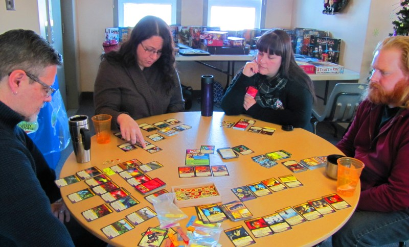 My first big game of the day: Sentinels of the Multiverse. With Chris, Lindsey, Tania, and Michael. ((We triumphed over La Capitan in the Ruins of Atlantis. The heroes were KNYFE, Wraith, the Visionary, and the Naturalist. The Naturalist's rhino-form tanking ability was crucial in our victory.))