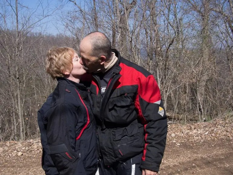 Ed and Cindy Jones smooching during a break in  the action.