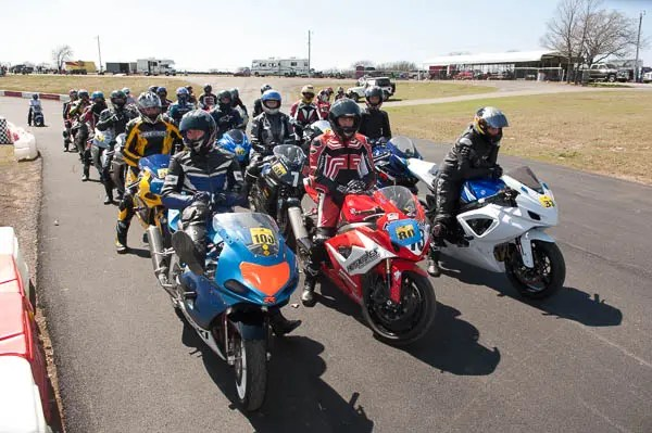 Motorcycles lined up to enter the track at Hallett during motorcycle lapping day.
