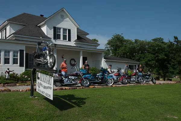 Several area motorcyclists gather in front of the Kickstart B&B
