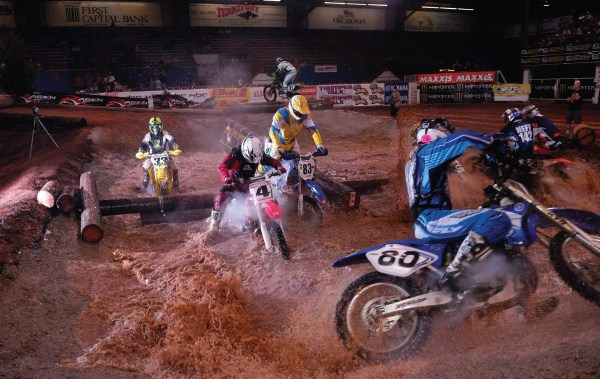 Endurocross riders brave a variety of elements such as water crossings and rocks on a man-made track.