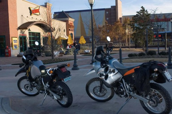 A couple of dual sport motorcycles parked at Bricktown Sonic.