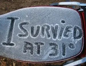 After a night spent in the freezing desert unprepared for the cold, Gary Miller scratched out a message on his frozen KLR seat.
