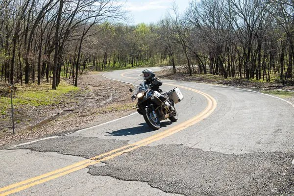 The roads are all paved and passable by any motorcycle, although the ride can be bumpy in places. Watch for loose gravel in the corners.