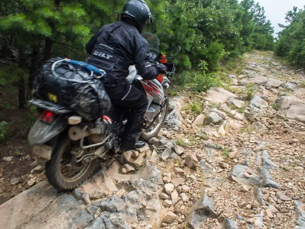 The K-trail is made up of rocks, big water puddles (not mud, just deep puddles) and more rocks. Most of the K-Trail can be ridden on a KLR but it can be work when fully loaded. We have seen BMW GS's ride the K-trail but you should be an expert rider before tackling parts of the K-Trail on a big dual sport. It is great fun on a 450cc and smaller dirt bike.
