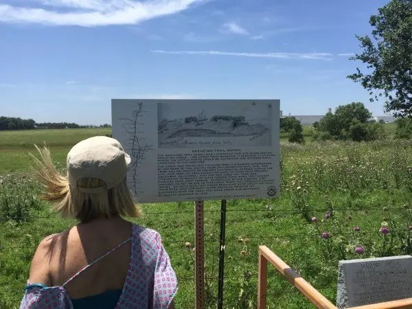 Kay reads the marker for Skeleton Creek Ranch.
