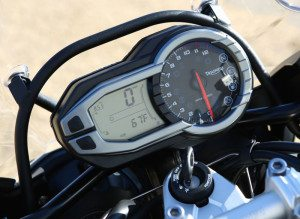 The Tiger Explorer XC has the same dash as the standard model, with an analog tach paired with a multifunction LCD display.