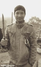 An Adi man with a dao, an essential multi-purpose working tools now rather than a weapon.