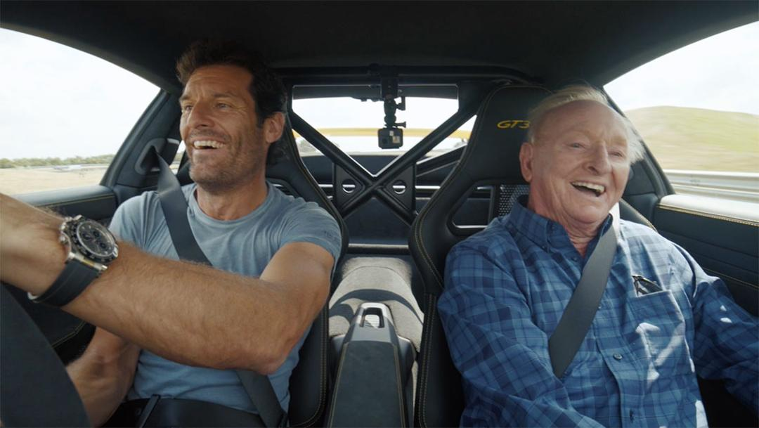 Rod Laver and Mark Webber pushing a 911 GT3 RS